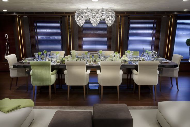 Harmony in colors doesn't stop in the upper deck salon of the CRN M/Y J'Ade 60m, where white cushions are alternated to jade-green ones.