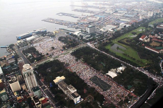 An aerial shot of people during a downpour of rain as Pope Francis celebrate a mass in Luneta on January 18, 2015. Photo from PAF-PIO/EPA