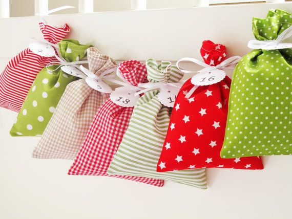 Countdown till Christmas: advent calendar bags for red green and white Christmas home decorations. Fabric advent calendars for kids which are perfect