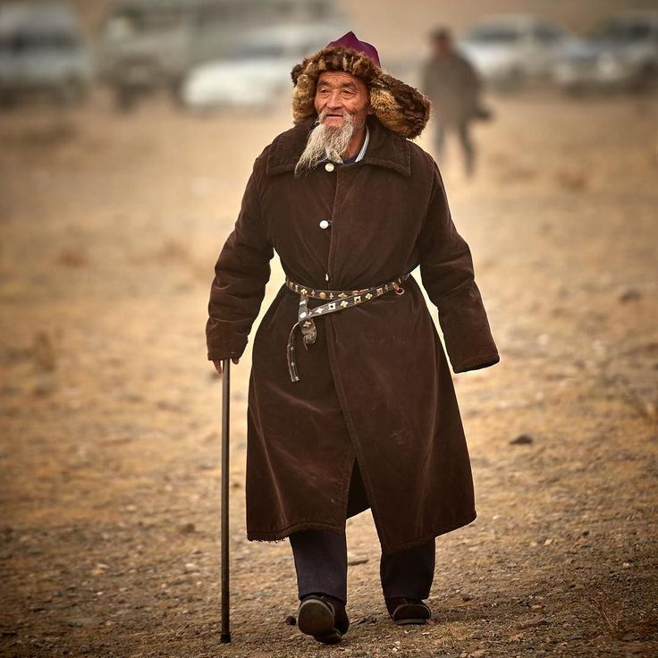 Follow me on Instagram http://ift.tt/2dOfd7l Oblivious to crowds at the Eagle Festival an elderly Kazakh man strode across the cold windswept dusty plain.  Stopping occasionally to greet an old friend and catch up on some gossip.  #mongolia #photoadventure #remotelocations #explore #withintheframe #kazakh #eaglefestival