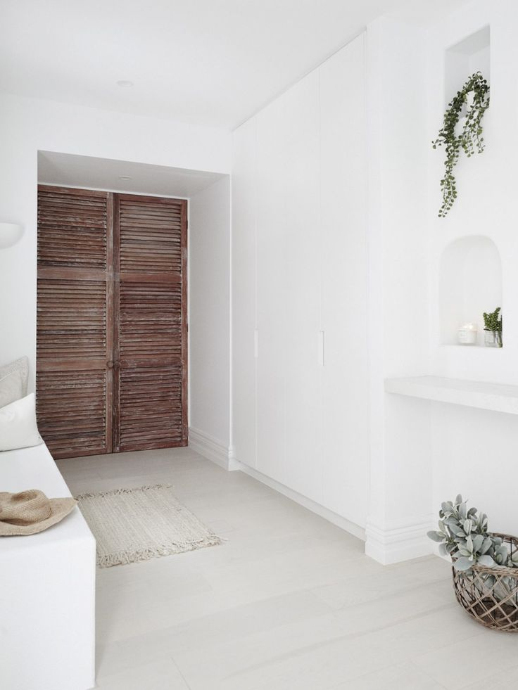 Three Birds Renovations design a mud room right at the front door of Lana Taylor's forever home as a take on urban family living.