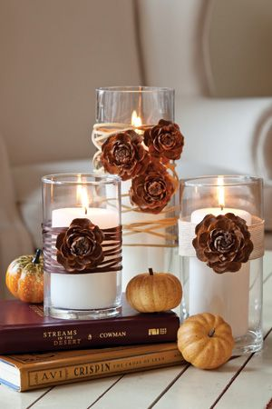 Thanksgiving Centerpiece: Wrap glass cylinders with ribbon, twine, and leather. Finish with pinecone flowers.