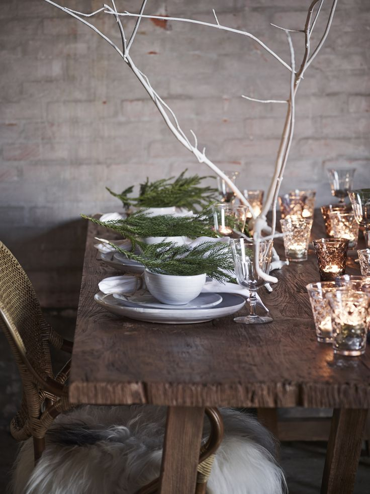 I'd like to use lots of natural folliage, in order to recreate the feel of having Christmas dinner a Scandi forest.