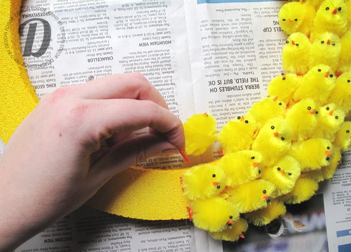 How freaking cute! chenille chicks wreath for Easter... wonder if I could do something similar with Peeps? :)