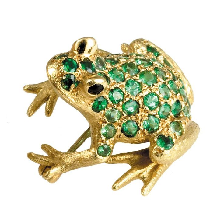 """Exclusive to Scully & Scully, This delightful frog, handfinished in England, is fashioned of 18k yellow and white gold and tsavorite garnets (2.10 tcw). It has onyx eyes.  7 ⁄ 8 """" x  7 ⁄ 8 """". The pink pin is K1209 (pink sapphires) and the blue is K1210 (blue sapphires). $4950"""