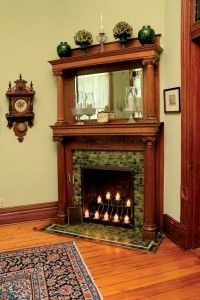 An original fireplace highlights a corner of the formal dining room in this Victorian home.