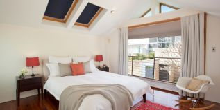 master bed, private balcony, city views, skylights, styled