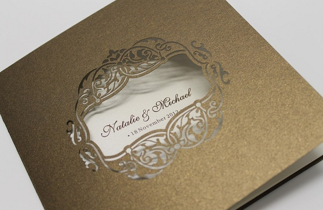 A laser cut frame detail on the outside of this folding bronze invitation is one of our new favourites!    https://www.facebook.com/RubyGreyCreative