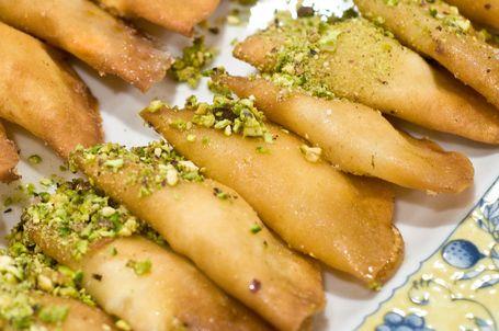 atayef syrian ricotta filled dessert pancake soaked in rose water