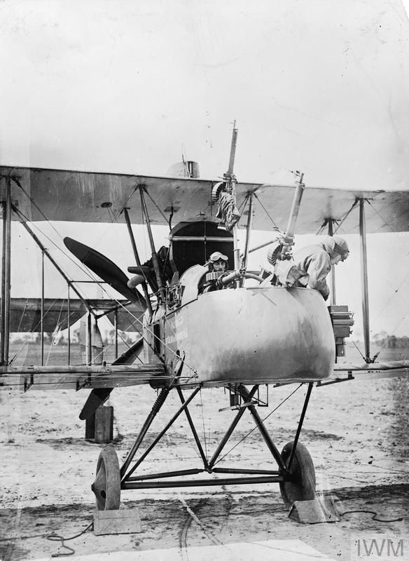 """Royal Aircraft Factory F.E.2d reconnaissance biplane of No. 20 Squadron RFC with """"L"""" Type camera at Sainte-Marie-Cappel, France. Serial number A6516. Crew: pilot Captain Stevens, observer B. C. Cambray. The aircraft has a message displayed on the fuselage reading: 'Presented by the Colony of Mauritius No. 13'"""