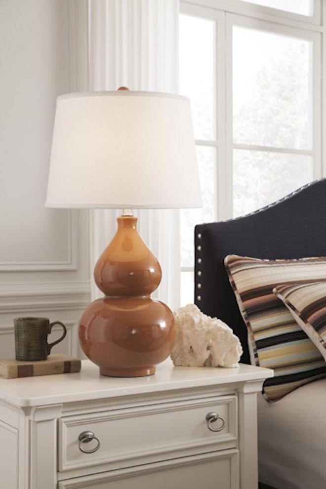 L100024 Saffia By Ashley Ceramic Table Lamp In Orange Contemporary St Ceramic Table Lamps Orange Table Lamps Ceramic Table