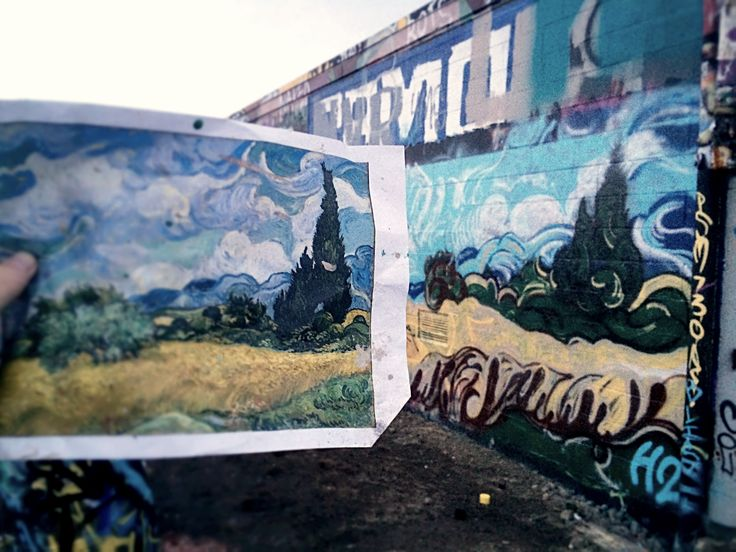 A spray paint rendition of Van Gogh's cyprus tree.