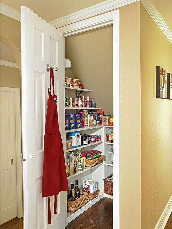 Establish an Efficient Pantry Convert the space under the staircase into a small room for storing food, paper goods, and extra cooking equipment. Add a door and wrap the three walls with shallow shelves.