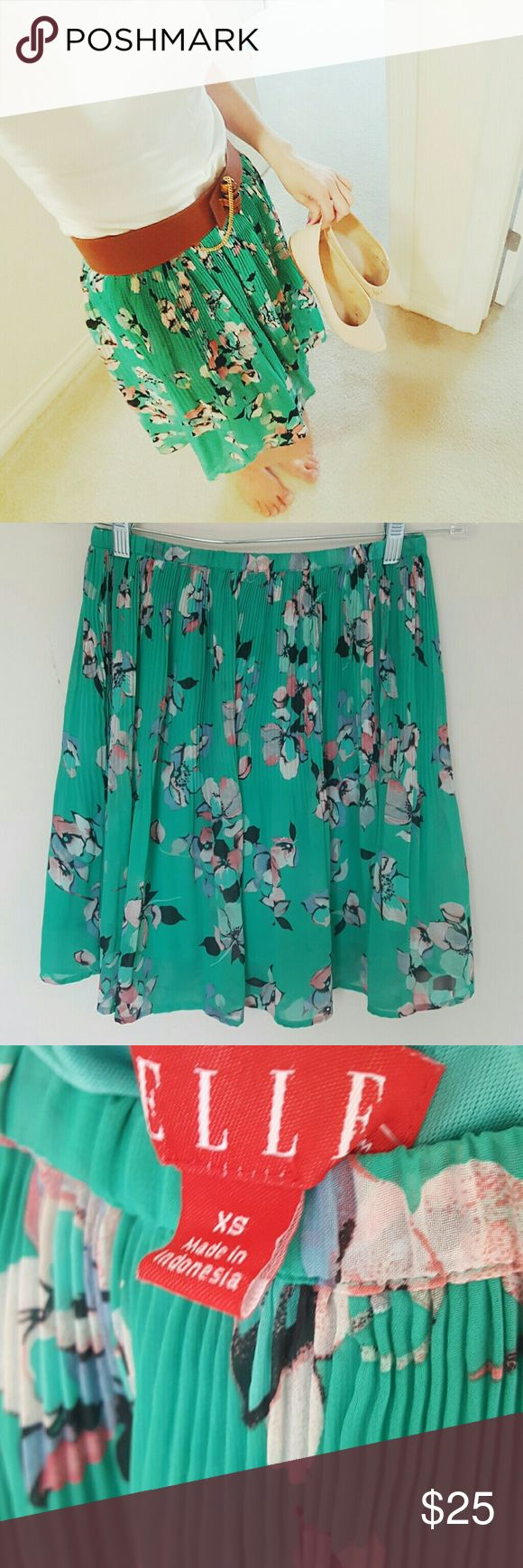 Pleated floral knee length skirt! Xs In excellent condition! Elle pleated floral skirt! On trend for spring and summer! Perfect with pointed toe heals or flats! Knee length. Size xs. I'm usually a 6, and I think this would fit sizes 2,4, and 6.  Bundle using the bundle feature and save! Elle Skirts