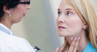 woman being examined for thyroid cancer