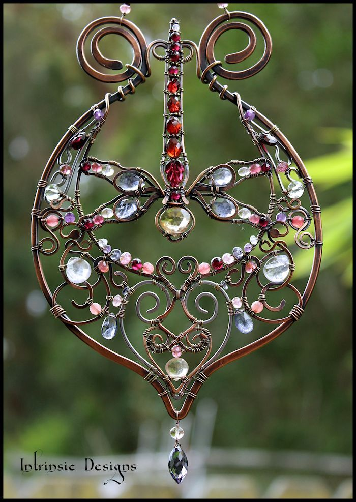Revamped Gemstone and Wire Suncatcher. I added a Dragonfly to make it more interesting and pretty!