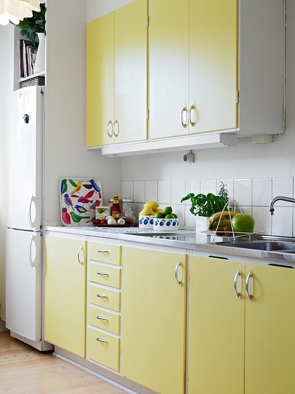 cute little kitchen -- love the colour of the cabinets