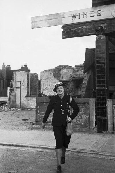 Women in Civil Defence: Mrs Edith Digby, a 43 year old Air Raid Warden, on duty in Blitz-damaged Bermondsey, London. - Mrs Edith Digby, an Air Raid Warden on duty in Bermondsey, London during the Second World War ~