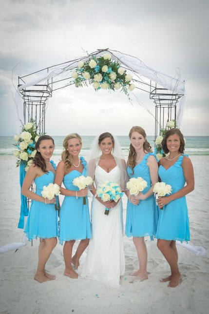 Turquoise Beach Wedding-Allure Bridesmaid Dresses www.linpaulsbridal.com. Love the bridesmaids dresses!