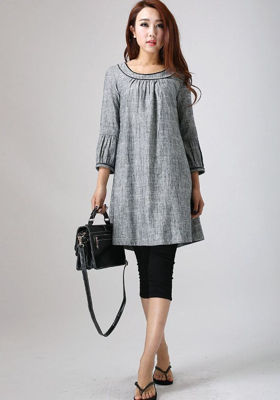 This adorable grey linen midi tunic dress looks so great with tights and flats as shown here. With its ¾ length sleeves, round collar and flared bottom,