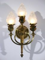 Circa 1900, really wonderful Pair of 3 Light Antique Torch Sconce Lighting Fixtures have Contemporary Flame Shades on two levels. They have a beautifully intact honey colored Brass Patina and hex detail on the arms and Shade holders. Very Close to the Wall, these Sconces have many Applications. Two levels on a Stairwell passage, in a Dining room or a Kitchen with our matching Patina Oil Chandelier. $1650.00 each