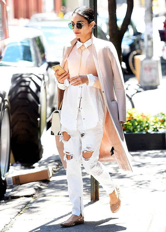 Vanessa Hudgens in a blush pink coat, color block blluse, distressed jeans, and oversized sunglasses