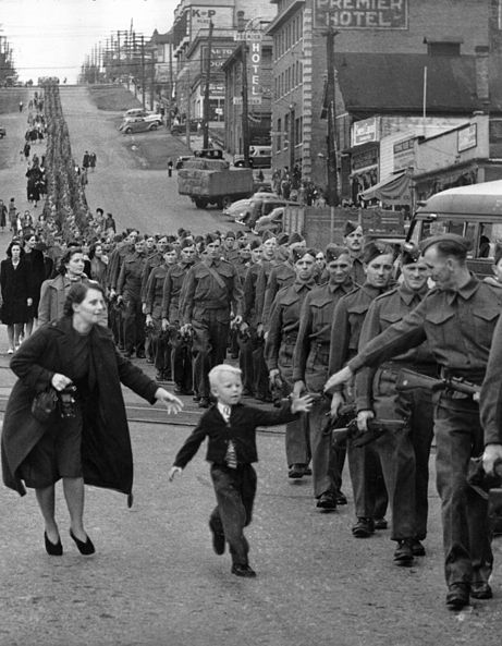 """Wait for me, Daddy"" is an iconic photograph taken in Vancouver in 1940 by Province newspaper photographer Claude Dettloff. It captured the touching scene of a five-year-old boy named Warren Bernard running after his father, Private Jack Bernard, as he marches off to war through the streets of New Westminster, British Columbia."