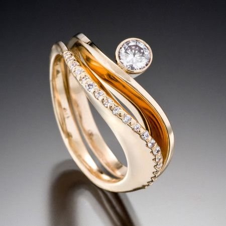 Grace and Covet Diamond A stunning pair. Unique and everlasting. Here the Grace ring is shown in 14kt yellow gold with a .33 carat center diamond stacked upon the Covet ring, also in yellow gold, featuring 21 pavé set diamonds.