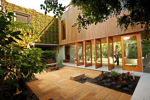 Venice Beach courtyard gorgeous living wall + wood doors and architecture