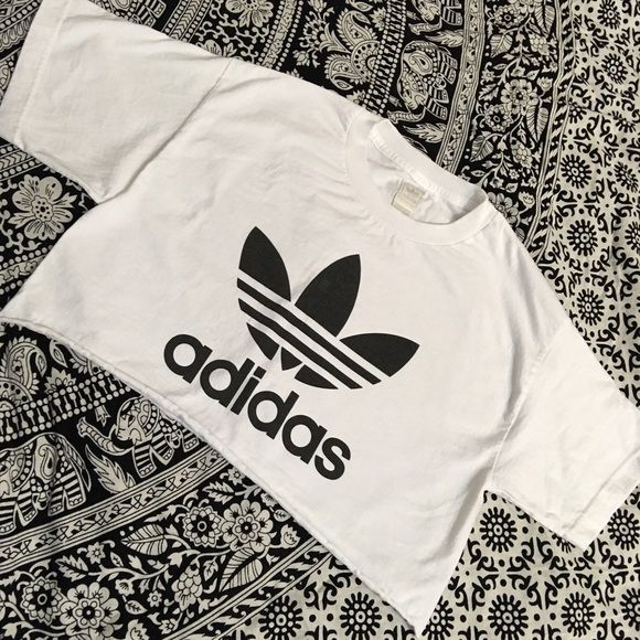 ✨white adidas custom crop top✨ New custom Adidas crop top  Adidas authentic  Color: White with black Adidas logo                                                              Premium quality   ❎No trades ❎Price firm  tags: shopcapri, adidas, adidas originals, yeezy, crop top, kanye west, kylie jenner, crop, top, black, white, shirt, the weeknd, abel, drake, hotline bling Adidas Tops Crop Tops