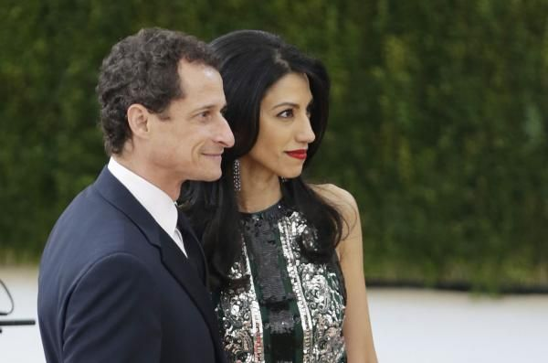 Former U.S. Rep. Anthony Weiner, D-N.Y., and former Hillary Clinton aide Huma Abedin agreed Wednesday to settle their divorce out of court.