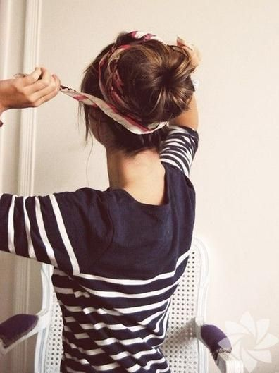 A printed scarf adds a fresh twist to a classic sock bun, and leaves you feeling as fresh as your hairdo looks.