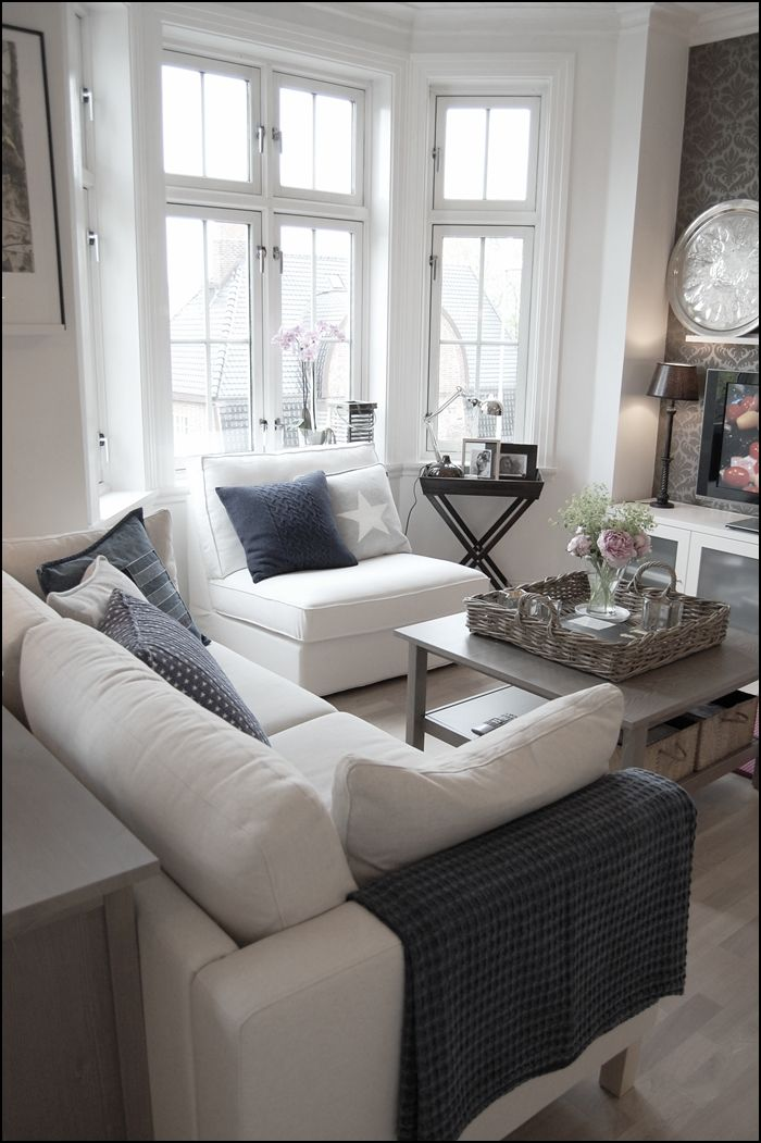 Lots of light, and lots of white with nice grey accents. Perfect. Love the wallpaper accent.