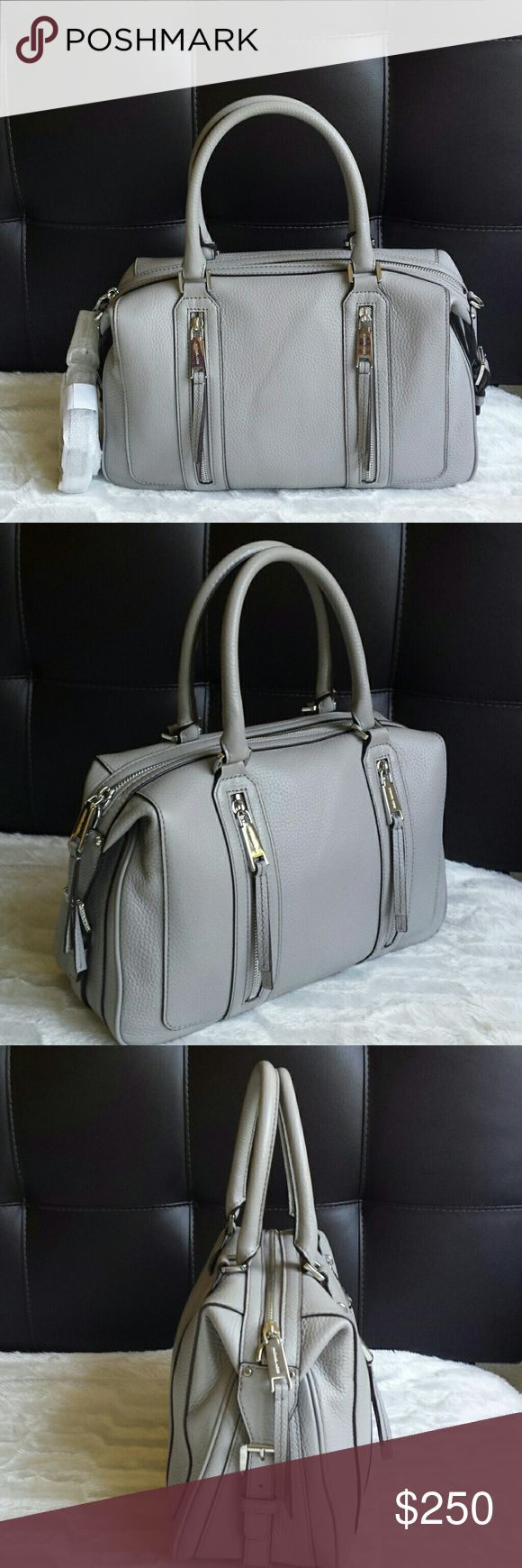 Michael Kors Julia Satchel Leather Pearl Grey Michael Kors Julia Large Satchel Leather in Pearl Grey  New with tag! Silver hardware. Never worn!  Two zip pocket in front, 1 slip pocket at back. Inside: beige lining, 1 zip pocket, 4 slip pockets.   This pearl grey is perfect all year round, look good in winter or summer! Michael Kors Bags Satchels