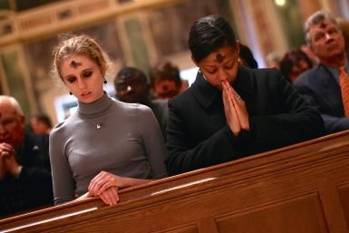 Should Catholics Keep Their Ashes on All Day on Ash Wednesday?: Catholics pray during an Ash Wednesday Mass at the Cathedral of Saint Matthew the Apostle