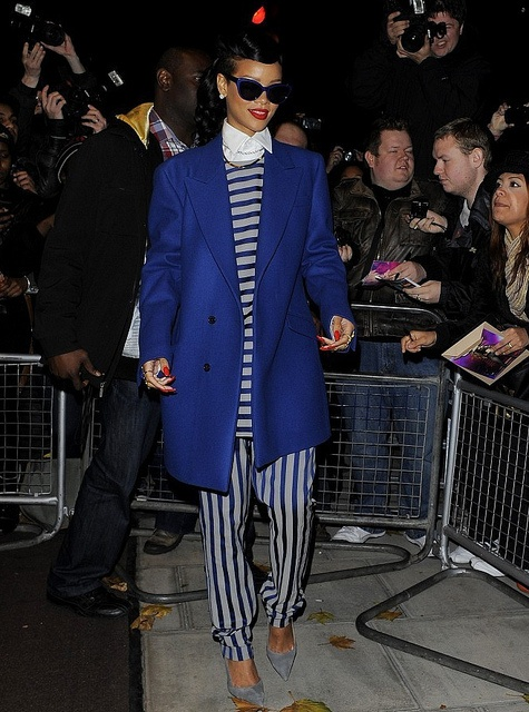 Rihanna in a striped tunic and pants from Acne's spring 2013 Menswear collection. Awesome.