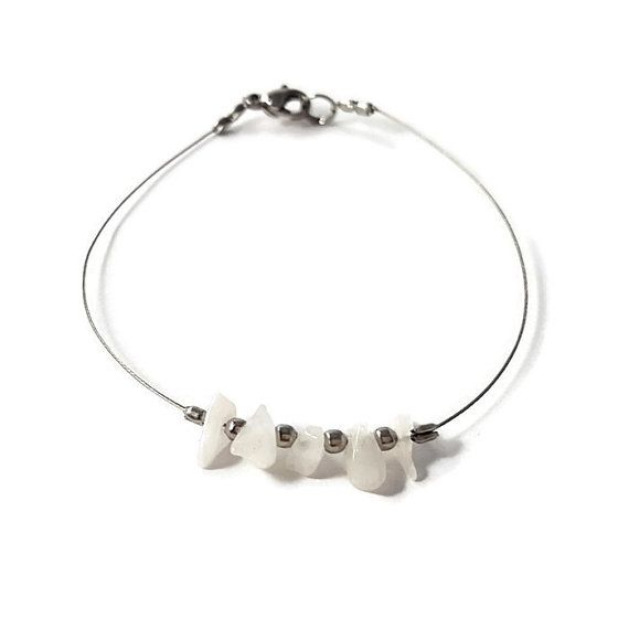 """✿ In the """"Shiny"""" #Jewelry, you will find #dainty #silverBracelet adorned with Rainbow #Moonstone (#naturalGemstone) and #silvery #beads. This #delicate #bracelet is #handmade with natural #RainbowMoonstone chips and #stainlessSteel beads on #silver wired steel (hypoallergenic)  ☯ Moonstone is associate with the feminine. Moonstone enhances self-acceptance and promotes sensitivity.  #etsy #etsyshop #etsyfinds #woman #womenfashion #fashionjewelry…"""
