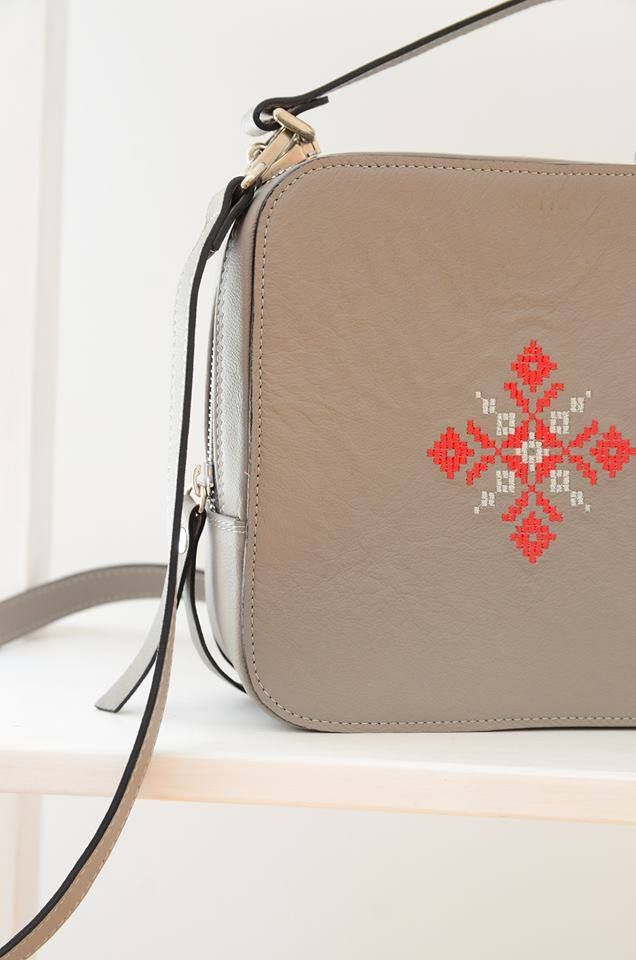 Iutta Magpie bag with signature white and red embroidery on grey leather. Can be worn cross-body. The motif is traditional Romanian. #romania #leathercraft