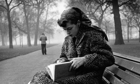 Journalist Katharine Whitehorn braves the elements with a book in London's Hyde Park in March 1956.