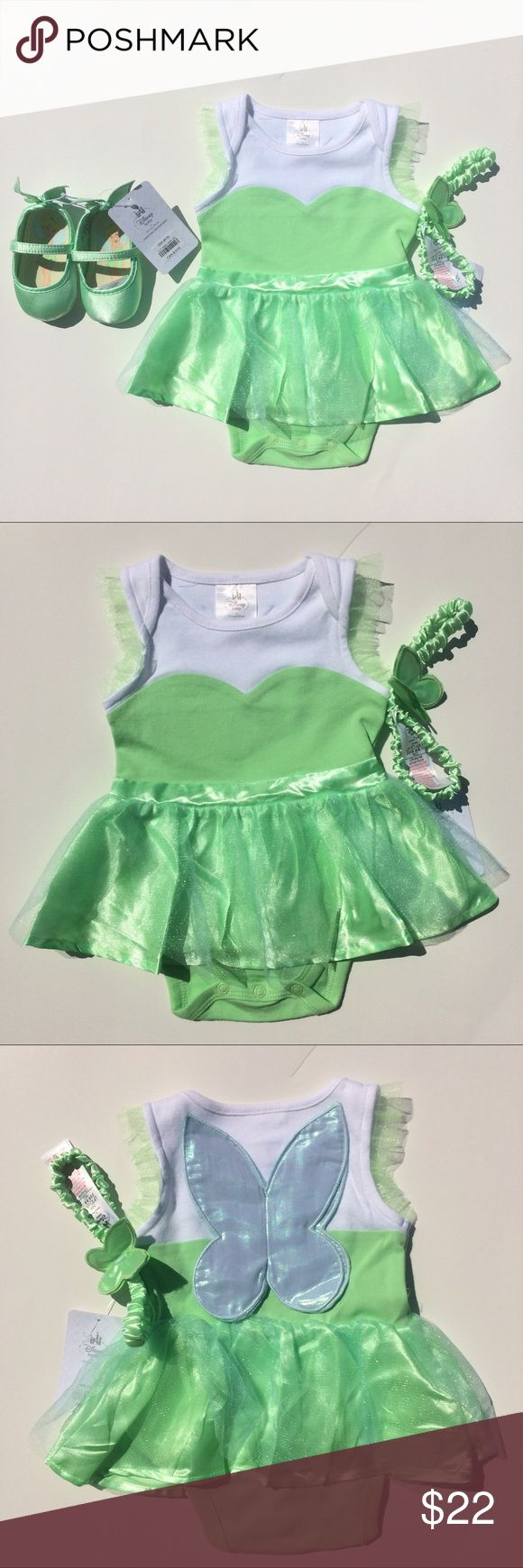 Disney Tinkerbell Outfit For Baby Girl 6-9 months This Cute Tinkerbell outfit is perfect for your little girl! The set includes little Tinkerbell shoes, a headband, and a cute little one piece outfit! Disney One Pieces Bodysuits