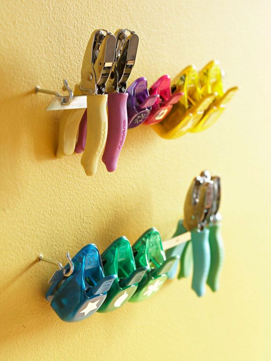 Keep scissors handy by looping a cord through the handle and hanging the pair on a cup hook attached to a shelf. Store wrapping paper rolls upright in an umbrella stand or wastebasket. Use fishing-tackle boxes to organize small sundry items such as threads, buttons, beads, and scrapbook embellishments.                                         -- Sy John Iverson, designer