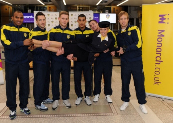 HIGH-FLYERS: United players Rodolph Austin, Adam Drury, Tom Lees, Lee Peltier, Ross McCormack and Luciano Becchio with Monarch hostess Janine Mullin. PIC: Andrew Varley