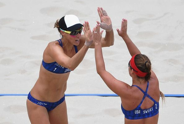 Lauren Fendrick, left, celebrates with Brooke Sweat of the United States during the women's beach volleyball preliminary round Pool A match against Kinga Kolosinska and Monika Brzostek of Poland on Day 2 of the Rio 2016 Olympic Games at the Beach Volleyball Arena on Aug. 7, 2016 in Rio de Janeiro, Brazil.