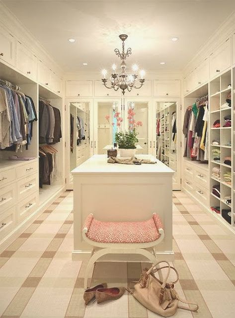 Fabulous his and hers closet, large island, mirrored doors, carpet. What a dream closet.