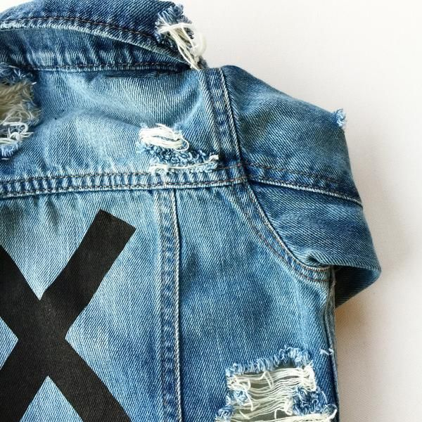 """X it distressed jean jacket Screen printed X Distressed on front, back, shoulder and elbowUnisex Size up if in between sizes/ size up for a over sized lookThis is listed as a pre order and is set to ship in 2-3 weeks Approximate Size chart 6-9 Months- 18-22 lbs / 27-29"""" 9-12 Months- 22-26 lbs / 29-30.5"""" 12-18 Months- 26-28 lbs / 30.5-32"""" 18-24 Months- 28-30 lbs / 32-33.5"""" 2T- 30-32 lbs / 33.5-35"""" 3T- 32-35 lbs / 35-38"""" 4T- 35-39 lbs / 38-41"""" 5T- 39-45 lbs / 41-44"""""""