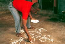 Vodun priest drawing a vève for ceremony in Haiti.