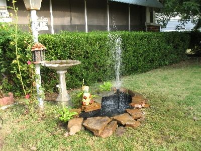 10 images about small garden ponds on pinterest for Front yard pond ideas