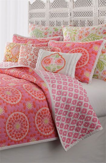 Brighten your boudoir with a color-burst cotton quilt that reverses to a charming pink-on-white design.