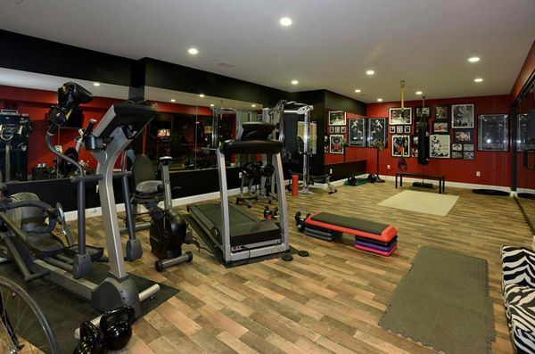 Very nicely equipped basement gym for both lifting and cardio
