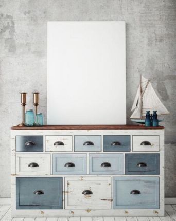 The combination of grey walls and the multiple shades of blue on the drawers of the dresser allows it to stand out.